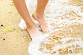 Young girl legs in sea — Stock Photo