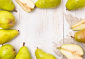 Pears on a white wooden table. Frame. — Stock Photo