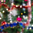 Blured background of a christmas tree with colourful lights — Stock Photo #8763280