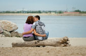 Loving couple is kissing at sea beach — Stock Photo