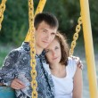 Man and woman on the swing — Stock Photo