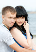 Loving young couple is embracing — Stock Photo