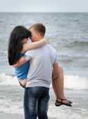 Loving young couple at sea — Stock Photo