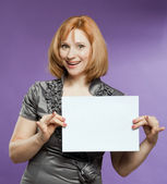 Beautiful woman with a blank (paper) for your text — 图库照片