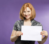 Beautiful woman with a blank (paper) for your text — Stock Photo