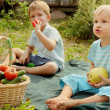Stock Photo: Kids with vegetables and fruits