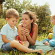 Woman with kids on a picnic — Stock Photo