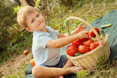 Baby and vegetables — Stock Photo