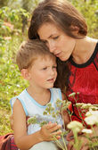 Baby and mom in the summer outdoors — Stock Photo