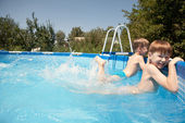 Children in the outdoor pool — Stock Photo