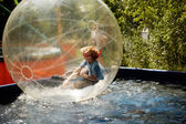 Boy inside a transparent sphere — Foto Stock
