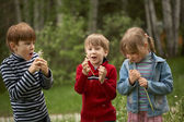 Children with dandelions — Stock Photo