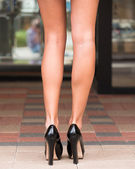 Long legs and high heeled shoes — Stock Photo