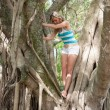 Stock Photo: Pretty Womin tree