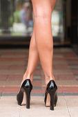 Black High Heels on Paver Block — Stock Photo