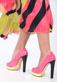 Stylish pink high heels with a green yellow trim — Stock Photo