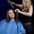 Hair stylist working on haircut — Stock Photo #18896203