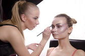 Beautiful girl model, while make-up before shooting session — Stock Photo