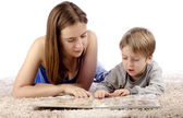Mother and child reading picture book — Stock Photo