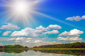 Lake And sun In The Sky Behind Wood. — Stock Photo