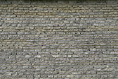 Wall from a granite brick — Stock Photo