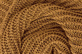 Close up golden knitted pullover background — Stock fotografie