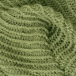 Close up green knitted pullover background — Stock Photo