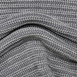 Foto Stock: Close up grey knitted pullover background