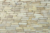 Close up wall covered with decorative stone — Stock Photo