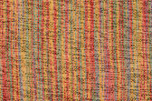 Close up varicolored knitted carpet background — Stock Photo