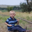 Stock Photo: Cute little blond boy playing on railway