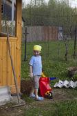 Cute little boy working in garden — Stock Photo