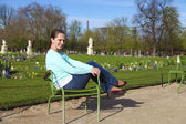 Attrective woman having rest in chair in Tuilleries garden of Pa — Stock Photo