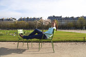 Beautiful woman having rest in the Tuileries garden — Stock Photo