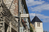 Hotel sign over building entrance in old town — Stock Photo