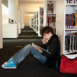 Young student in library — Stock Photo