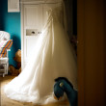 Постер, плакат: Wedding dress in nursery