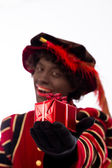 Black Pete showing gift — Stock Photo
