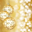 Foto Stock: Three beautiful golden christmas balls