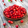 Fresh red berries on wooden table — ストック写真
