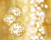 Drie prachtige gouden kerstballen — Stockfoto