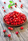 Fresh red berries on wooden table — Stock Photo