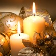 Christmas decoration with candles over dark background — Stock Photo