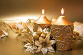 Christmas decoration with candles and ribbon — Stock Photo