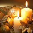 Christmas decoration with candles over dark background — Foto Stock