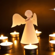 Foto Stock: Christmas angel with candles
