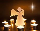 Christmas angel with candles — Stock Photo
