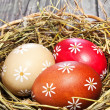 Colorful easter egg in the basket — Stock Photo #18665643