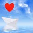 Paper ship with red heart sail — Foto Stock