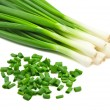 图库照片: Chopped green onions on white